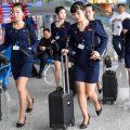 朝鲜空姐着新版制服亮身机场 裙子高度首上膝盖